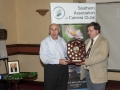 Seamus O'Donoghue presenting SACC Chairman Bill Power with new trophy in honour of the late Larry Stewart