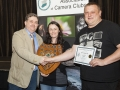 SACC Chairman Bill Power presenting Niamh Whitty & Jason Town from Cork Camera Group trophy and certificate for winning Colour Print Panel