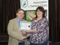 SACC Chairman Bill Power presenting Cathy Rossiter from Wexford Camera Club with certificate for second place Monochrome Print Panel