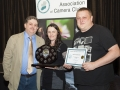 SACC Chairman Bill Power presenting Niamh Whitty & Jason Town from Cork Camera Group trophy and certificate for winning Projected Image Panel