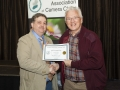 SACC Chairman Bill Power presenting John Cuddihy from Kilkenny Photographic Society certificate for third place overall