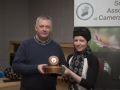 SACC Chairman Richie Dwyer pictured with Natalja Murphy picking up best colour print award on behalf of clubmate Vladimir Morozov.jpg