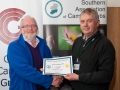 SACC Chairman Richard Dwyer pictured presenting award for third colour print panel to Rory O'Connor from Blarney Photography Club