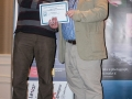SACC Secretary David Barrie presenting award to Bill Power